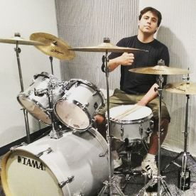 Teacher Bruno on his drumset in the studio.